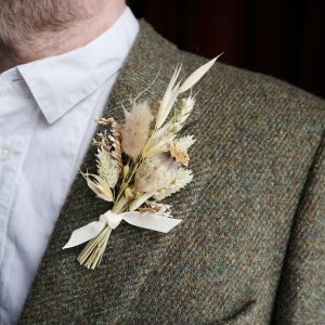 Neutral Dried Flower Buttonhole on Tweed Jacket